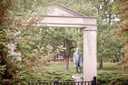 Kirksville, Missouri / USA - May 27 2018: Archway and Joseph Baldwin Statue on Truman State University Campus