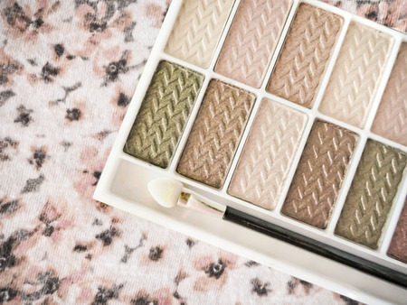 Pink and Tan Eye Shadow Palette on Floral Background Stock Photo