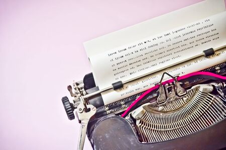 Antique Typewriter on Pink Background