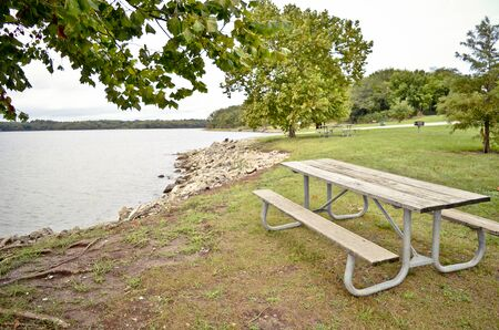 Picnic Table Beside a Lake Banco de Imagens