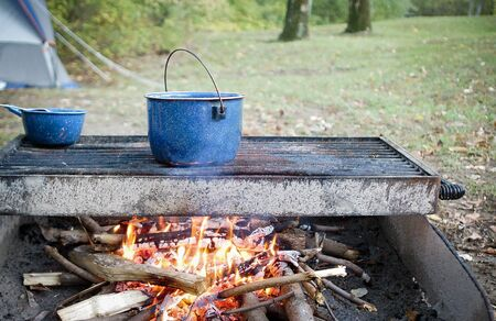 Campfire with Blue Cooking Pans Banco de Imagens