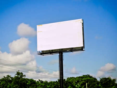 Blank White Billboard with Blue Sky Clouds and Trees