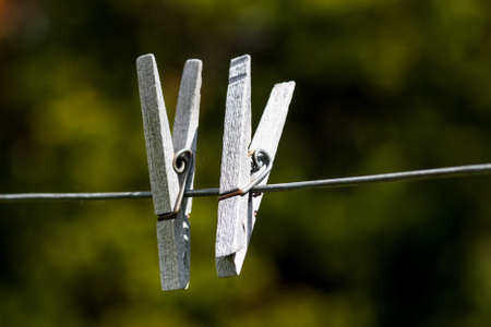 old wooden clothespins on wire line