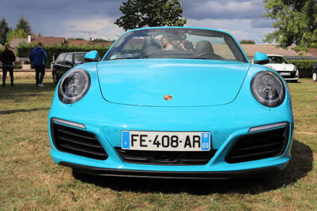 """Porsche 911 convertible, turquoise blue convertible sports car, gathering of sports and vintage cars on September 8, 2019 called """"Les Bambanes Lyonnaises"""", town of Chaponnay, Rhône department, France Editorial"""