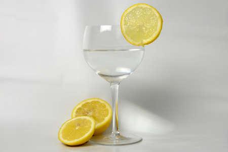 halved  half: Glass of water with lemon Stock Photo