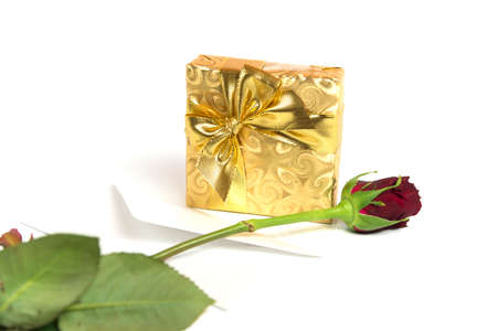 Present with letter and red rose Stock Photo