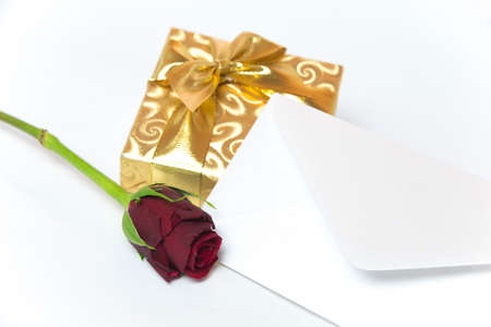 whitern: Present with letter and red rose Stock Photo