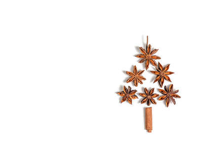 Creative, Christmas and New Year, Winter composition. star anise and cinnamon sticks on a white background. Stok Fotoğraf