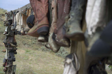 This display of retired old worn cowboy boots is wonderfully displayed Stock Photo - 14570665