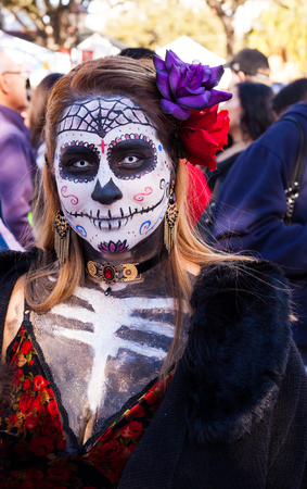 SAN ANTONIO, TEXAS - OCTOBER 28, 2017 - Woman wears face and body paint for Dia de los MuertosDay of the Dead celebration. Day of the Dead is a Mexican holiday celebrated throughout Mexico, in particular the Central and South regions, and by people of Me