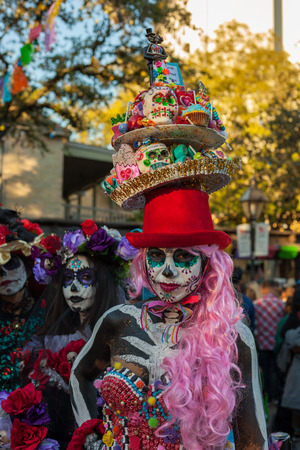 SAN ANTONIO, TEXAS - OCTOBER 28, 2017 - Woman wearing a colorful and intricate costume for Dia de los MuertosDay of the Dead celebration. Day of the Dead is a Mexican holiday celebrated throughout Mexico, in particular the Central and South regions, and
