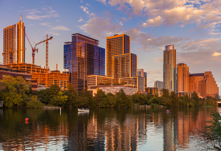 Austin, Texas with new buildings rising, reflecting in lady Bird Lake during sunset  Austin Skyline and new constructions Stock Photo