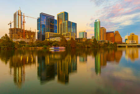 Austin, Texas with new buildings rising, reflecting in lady Bird Lake during sunset  Austin Skyline and new constructions Editorial