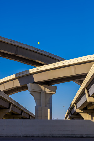Section of elevated higway with several levels against a bright blue sky Archivio Fotografico