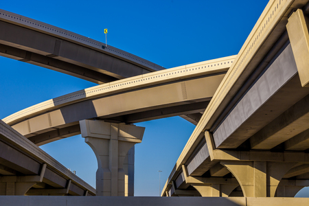 Section of elevated higway with several levels against a bright blue sky Stock Photo