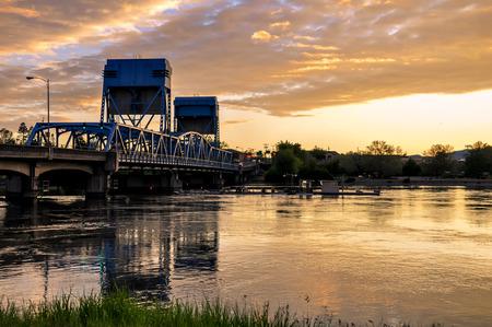 Lewiston - Clarkston blue bridge against vibrant evening sky 写真素材