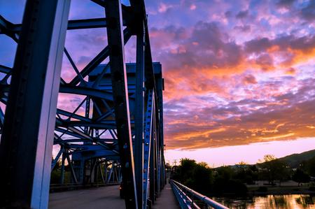 Section of the Lewiston - Clarkston blue bridge against vibrant twilight sky
