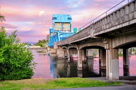 Lewiston - Clarkston blue bridge against sky with pink clouds