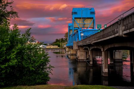 Lewiston - Clarkston blue bridge against vibrant twilight sky