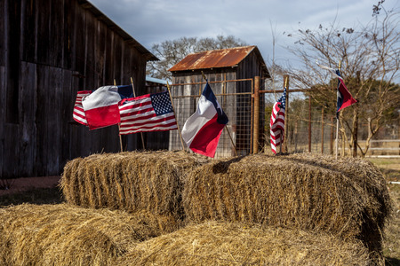 The American and Texas flags arranged on straw bales, independence day decoration Foto de archivo