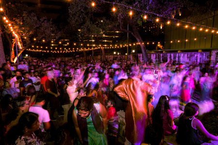 SAN ANTONIO, TEXAS - NOVEMBER 4, 2017 - Motion blur of people who dance and sing at the Hindu Diwali Festival of Lights, one of the most popular festivals of Hinduism
