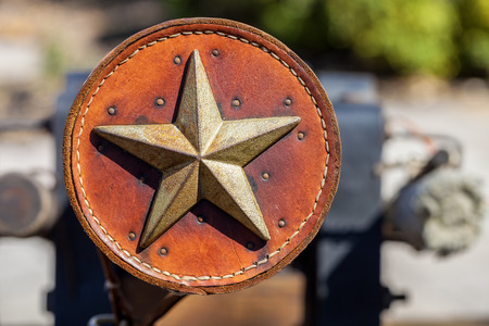 Antique leather ornament decorated with metal Texas star Stockfoto