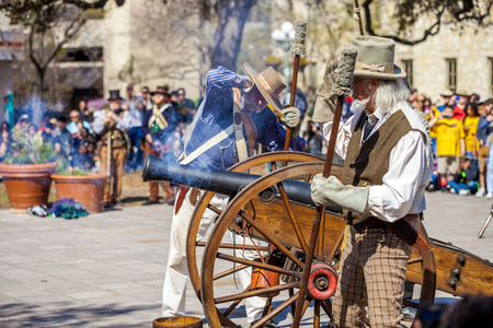 SAN ANTONIO, TEXAS - MARCH 2, 2018 - Men dressed as 19th century soldiers fire antique cannon for the reenactment of the Battle of the Alamo, which took place between February 23 and March 6, 1836