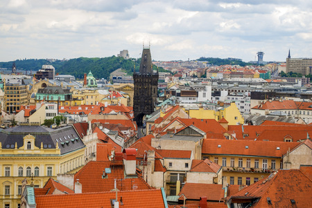 Birds eye view of the city of Prague with overcast sky seen from the Old Town Hall Tower, also known as the Clock Tower Stock Photo