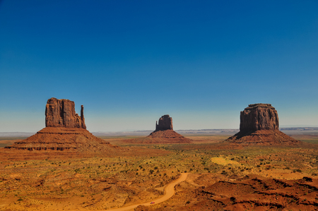 The Mittens and Merricks Butte, rock formations, in Monument Valley, Arizona 스톡 콘텐츠