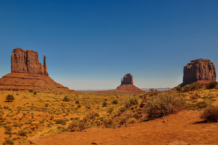 The Mittens and Merricks Butte, rock formations, in Monument Valley, Arizona Stock Photo