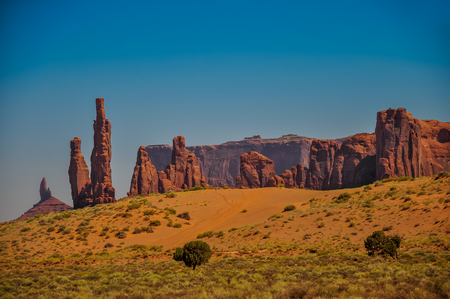 Rock formations called Totem Pole and Yei Bi Chei in iconic Monument Valley, Arizona 스톡 콘텐츠