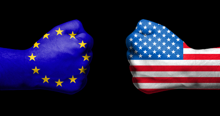 Flags of European Union and USA painted on two clenched fists facing each other on black backgroundEuropean Union versus USA trade disputes concept