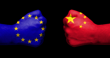 Flags of European Union and China painted on two clenched fists facing each other on black backgroundEuropean Union versus China trade disputes concept