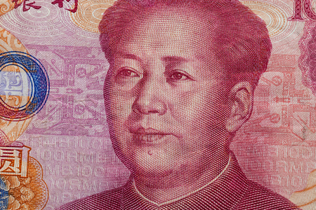 Close up of one hundred Yuan banknote with focus on portrait of Chinese statesman Mao Tse-tung Stock Photo