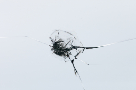 Closeup  of cracked windshield with fissure lines, abstract background with copy space 스톡 콘텐츠