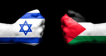 Flags of Israel and Palestine painted on two clenched fists facing each other on black backgroundIsrael - Palestinian conflict concept Stock Photo