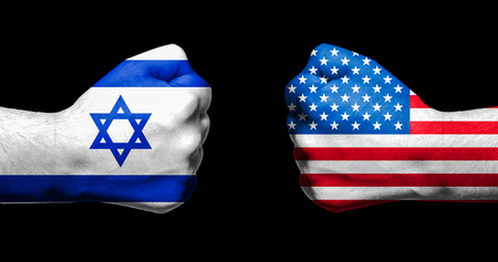 Flags of Israel and USA painted on two clenched fists facing each other on black backgroundIsrael - Unitaed States relations concept Stock Photo