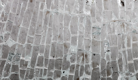 Abstract background of dirty shattered glass into small rectangular pieces