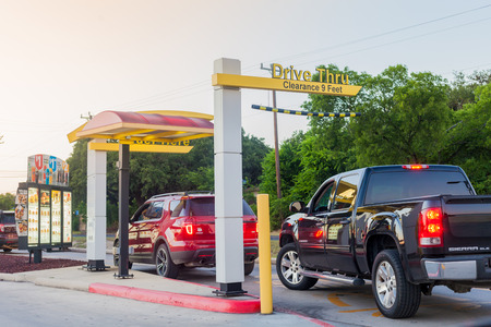 SAN ANTONIO, TEXAS - MAY 29, 2018 - Cars in line at a McDonalds restaurant drive thru in San Antonio, Texas.