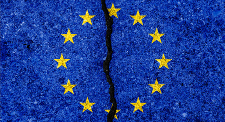 Flag of European Union painted on cracked wall background/Divided European Union concept Фото со стока