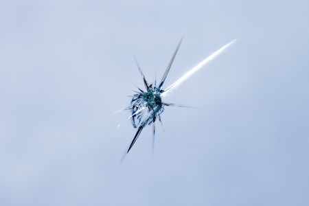 Closeup of cracked windshield with fissure lines, abstract background with copy space Stock Photo