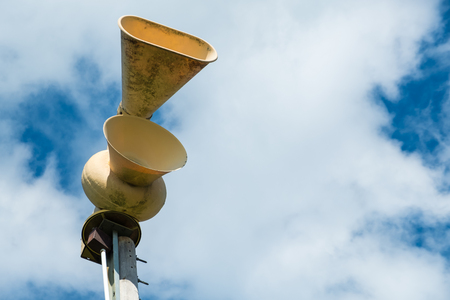 Old mechanical civil defense siren, also known as air-raid siren or tornado siren Archivio Fotografico