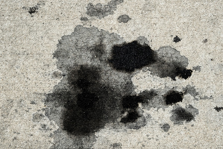 Motor oil stains on concrete pavement/texture background Stockfoto