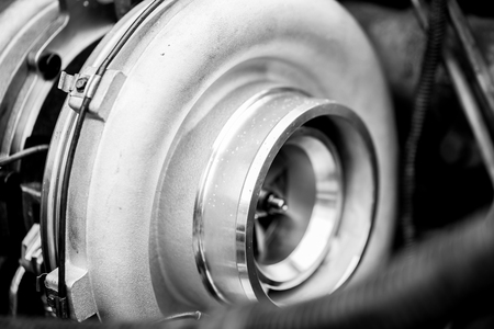 Close up detail of a diesel engine turbocharger , side view with selective focus