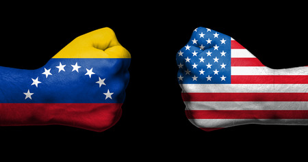 Concept of relations/conflict between Venezueal and the United States of America symbolized by two opposed clenched fists