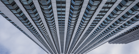 Abstract low angle view of skyscraper. Pattern of vindows on a tall building, diminshing perspective. Stock Photo