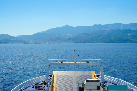 Bow of a ferry in Thasos, Grece during a sunny summer day with view of the Aegean sean. Vacation destination concept Stock Photo