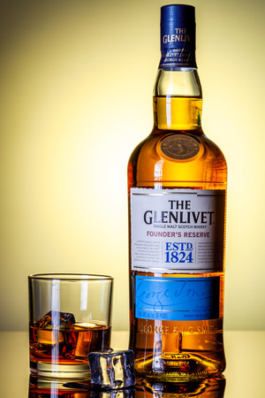 SAN ANTONIO, TX - DECEMBER 31, 2019 - Bottle of The Glenlivet founder`s reserve single malt scotch whiskey with glass and ice on a reflective surface