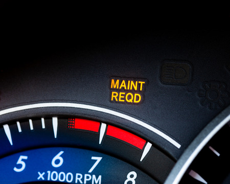 Engine maintenance or service light is on in car dashboard. Car dashboard cluster background