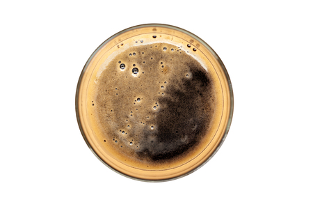 Glass of dark beer, top view with creamy froth - isolated on white Фото со стока
